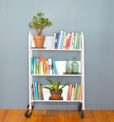 That's it. I need a library cart. Smart tip for keeping planters level on the slanted shelves, too!