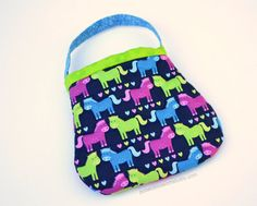 Just right for my two year old!  I love quilted fabrics, and she loves ponies.   Handmade from Potato Blossom Studio on Etsy.