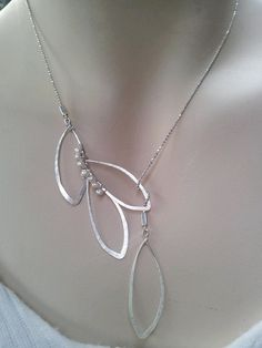 ♤Have the beads strung in a waiver stream, more fluidly. (Lariat leaves necklace with tiny fresh water by MiritLevinJewelry, $280.00)<-- is that really the price????  Ridiculous!