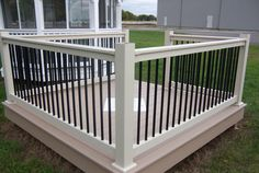 Black with White Vinyl Deck Railing See plenty Deck Railing Ideas http://awoodrailing.com/2014/11/16/100s-of-deck-railing-ideas-designs/