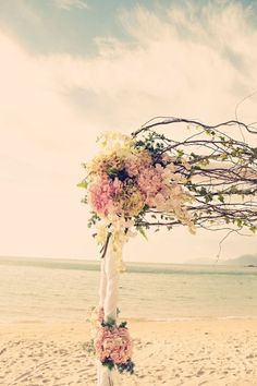 Floral wedding arch on the beach