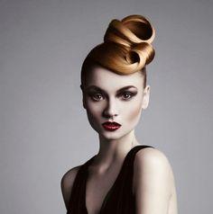 Gorgeous modern yet simple upstyle. True hair artistry by Nadege Faverais of the U.K.