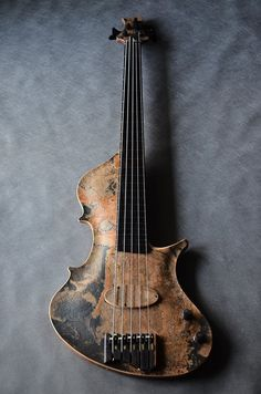 The slightly arched top and sloping curves of the bouts are faintly yet evocatively reminiscent of the ancient viola da gamba heritage of this instrument.