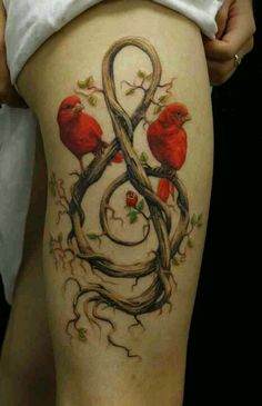 Red bird music note tattoo, rose vines, nature ink, thigh piece