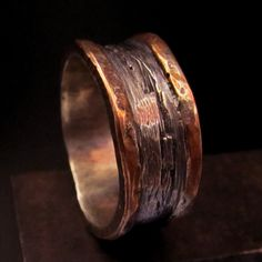 Clunky but fascinating. Mens textured silver copper silver.
