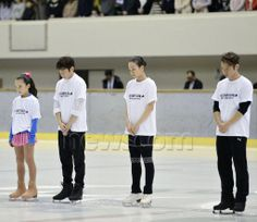 Japanese figure skaters, including Daisuke Takahashi (R) and Mao Asada (2nd from R), observe a moment of silence in honor of victims in the Great East Japan Earthquake of March 2011 at a charity event to support reconstruction from the disaster held in Kobe on April 2, 2014. (Kyodo) (512×443)