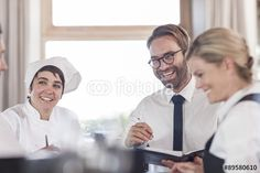 Restaurant team discussing menue and reservations Restaurant, Stock Foto, Fashion, Pictures, Royalty Free Images, Moda, La Mode, Diner Restaurant, Restaurants