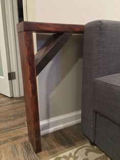 Cheap and easy behind the sofa table shelf.