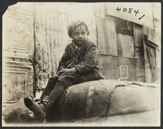 This young boy seated in the street, on a burlap sack, displays the abysmal living conditions of immigrant tenement children on the Lower East Side of Manhattan. Not such 'gilded' living conditions for them, during America's Gilded Age - late19th-century/early 20th-century. ~ {cwl} ~ (Image/collection: Columbia University Libraries)