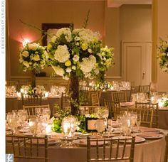 Tall floral arrangements were tailored to fit Lindsay's rustic meadow theme. The centerpieces were designed to look like flowering trees made of snapdragons, hydrangeas, orchids and gardenias.