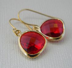 Ruby Red Dangle Earrings in Gold  by Greenperidot on Etsy, $19.50  Purchased these to match my ring given to me by Bradley. Can't wait to see them in person :)