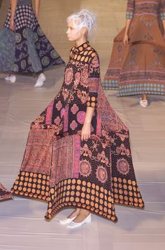 Issey Miyake S/S 2001. 17th/18th century meets 21st century. Farthingale/pannier/hoop skirt.