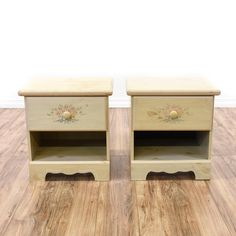 This pair of cottage chic nightstands are featured in a solid wood with a light blonde wood finish. These end tables have 1 drawer, a bottom cabinet cubby and hand painted flower accents. Adorable bed side tables perfect for a kids space! #cottagechic #dressers #nightstand #sandiegovintage #vintagefurniture