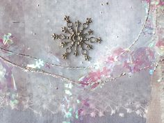 CAROLYN SAXBY TEXTILES - snowflake charm - a beautiful bundle of ice blue fabrics, silk, lace, snowflake garland and a silver snowflake charm - from a dear friend in Rhode Island. It has inspired something icy! Snowflake Garland, Snowflakes, Carolyn Saxby, Beast From The East, Pretty Beach, Holly Leaf, Art Archive, How To Make Tea, Textile Artists
