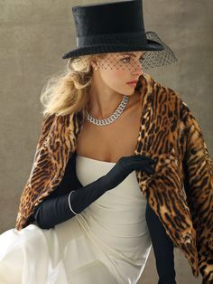 wedding dress + fur + top hat. yup.
