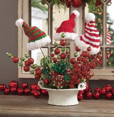 Arrangement using Red/Green Ball Sprays, Hats on a Stick and Package ornament from the Snowdoodles Collection