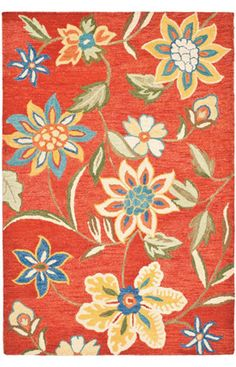 A bold choice, but I love it!  Safavieh Blossom Rust Rug