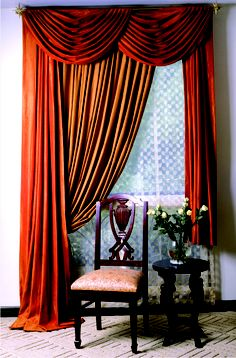 red velvet swags & drapery panels with secondary color panel hung where sheer would hang