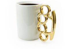 Put a little punch in your morning brew with this brass knuckle coffee mug.