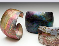 """Jane Adam """"cuts pieces from dyed & sealed aluminium & compresses in rolling mill, oft. introducing texture & marks... causes the anodic film to craze and break, reveals silvery metal to give a shimmery, iridescent effect. Interesting forms created by the stretching and deforming metal... gives the work an organic quality."""" Oh yeah - wow!"""