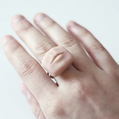 Eye-catching tiny human organ jewelries by London-based artist Percy Lau.