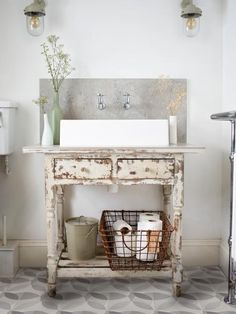 Amazing shabby-chic bathroom design with a well-worn paint finish on the bathroom vanity, light walls, patterned floor tiles and clean lines Lindsey Lang Design Ltd Cocina Shabby Chic, Shabby Chic Kitchen, Shabby Chic Homes, Shabby Chic Style, Shabby Chic Decor, Boho Chic, Diy Bathroom Vanity, Bathroom Furniture, Bathroom Ideas