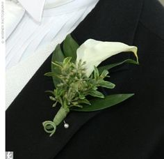 Love the small pigtail curl on the end of this boutonniere