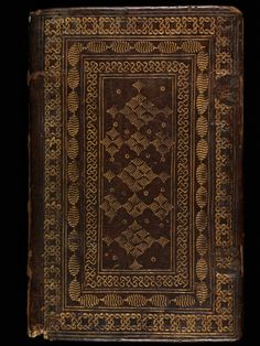 A leather binding is decorated with gold stamps #manuscript #illumination #leather #bookcovers #binding