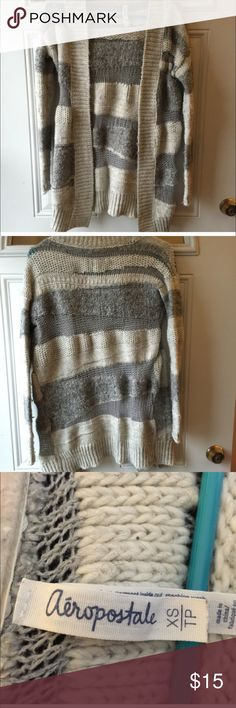Aeropostale Cardigan CLEARANCE Beautiful cream and gray stripped long cardigan. Made with wool and acrylic materials. Fits a little looser and could also fit a small.  Super warm and comfy. Aeropostale Sweaters
