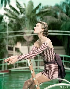 Vogue, May 1, 1954.                                         Someone finally solved the dilemma of how to swim without showing upper arm fat :-)