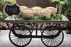 Popcorn Cart for your wedding  Host: Styled Shoots Across America Planning & Design: Heather Benge Venue: Madera Estates Flowers: Casa De Flores Rentals, Linens & Decor: Madera Luxe Hair & Makeup: BP Stationary: Memory Lane Furniture & Details: Love Birds Vintage Gowns: Moonlight & Moss Cake: Iced N Frosted Shoes: David Tutera Footwear