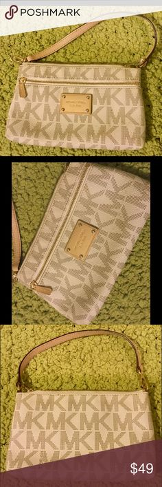 Michael Kors Large Jetset Wristlet Vanilla GUC Very light wear, signs of use. Light scratches on front tag. Gently used & it shows. This is the larger sized wristlet, big enough for most cells. I have TONS more high end & designer items to list so please check out rest of my stuff! The more you buy, the better the deal! Smoke free pet free home! Thanks for looking! Michael Kors Bags Clutches & Wristlets