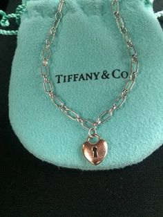 Tiffany And Company Silver Bracelet With Rose Gold Mini Lock. Get the lowest price on Tiffany And Company Silver Bracelet With Rose Gold Mini Lock and other fabulous designer clothing and accessories! Shop Tradesy now