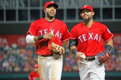 Elvis Andrus and Rougned Odor jog to the dugout as Rangers faced the Angels Monday, September 19, 2016. (Louis DeLuca/The Dallas Morning News)