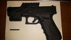 Glock with red dot mount.