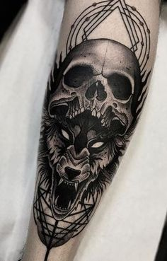 Amazing dotwork wolf and skull tattoo on forearm