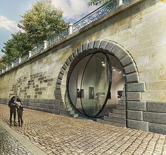 Prague´s Vltava river waterfront gallery spaces with round acrylic glass doors by Petr Janda