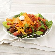 Easy Taco Salad | Diabetic Living Online.  I altered this by making my own taco meat and not buying the prepackaged stuff. I also used organic blue corn tortilla chips instead of baked Doritos. It's so good!