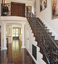 I love the iron on the staircase. I also love being able to see through to the back of the house!