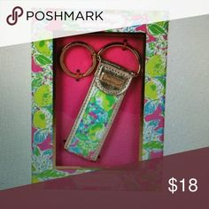 "NIB Lilly Pulitzer Key Fob in Pink Lemonade NIB Lilly Pulitzer Key Fob in Pink Lemonade Style #153618 Canvas material. Gold leatherette accents. Gold key ring and logo plaque. Measures 1.5"" x 4"". Ships from non-smoking home. Lilly Pulitzer Accessories Key & Card Holders"