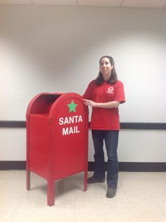A Mailbox for santa mail that I  made out of cardboard.  I used the same shapes and measurements of a USPS mailbox. I shortened the legs slightly to allow children to easily mail their santa letters. Made by T Cotter.