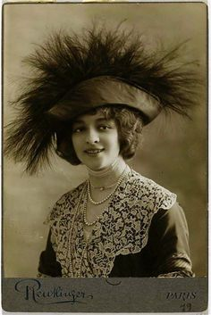 1910 Jane Ronouadt- pearl necklaces, lace collar, hairstyle, big feathers on hat