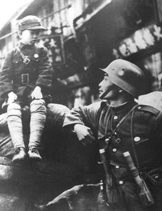 Chinese soldier with a military uniform-clad boy in Shanghai, China prior to the Japanese invasion, Jul-Aug 1937