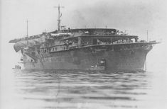 IJNS Kaga, 1930s, before refit. Sporting three flight decks and a long vented funnel with the outlet visible aft.