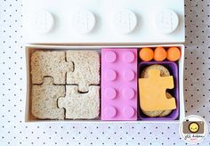 Puzzle sandwich, small inner lego container with box of raisins, crackers with cheese, and carrots. Love the Lego containers! Cute Bento Boxes, Bento Box Lunch, Lunch Snacks, Healthy Snacks, Kids Packed Lunch, Kids Lunch For School, School Lunches, Cute Food, Kids Meals