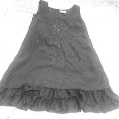 Nicole Miller black tunic tank with layered frills Nicole Miller black tank top. Tunic length. Zipper back. Two layers of frills at the bottom. Beaded pattern on the front. Polyester blend. Size L. Nicole Miller Tops Blouses