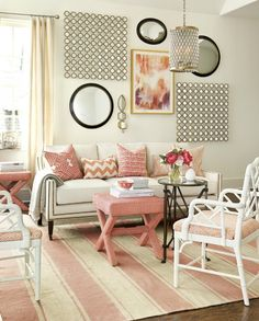 Bold pops of coral give this living room a youthful feel.