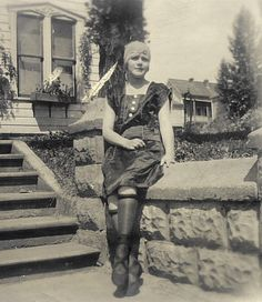 "Photo of a girl in ""flapper"" garb. Taken in Moscow, Idaho in 1922. Rolled stockings to show her knees."
