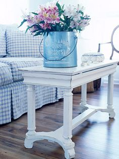 Using a piano bench as a coffee table = neat idea.