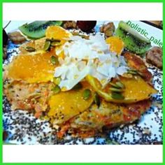 Delicious pancake with fresh orange, kiwi fruit, cherries, coconut flakes, maple syrup, pumpkin seeds, chia seeds, walnuts & maple syrup. The pancake is gluten, dairy & sugar free & is a great way to start the day. #breakfast#breakfastagram#paleorecipe#he